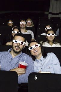 Couple with 3d glasses watching a movie in a cinemaの写真素材 [FYI04333998]