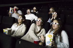 Scared people with 3d glasses watching a movie in a cinemaの写真素材 [FYI04334003]