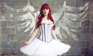 Portrait of woman with red hair and ballerina dress standingの写真素材 [FYI04334053]