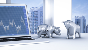 Bull and bear on desk with stock chart on laptopのイラスト素材 [FYI04334107]