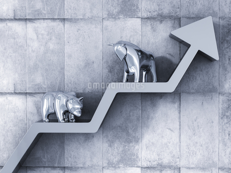 Bull and bear standing on upward pointing stock chartのイラスト素材 [FYI04334110]