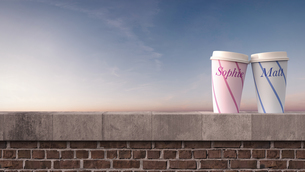 Two coffee mugs with names on wall at sunset, 3D Renderingのイラスト素材 [FYI04334140]