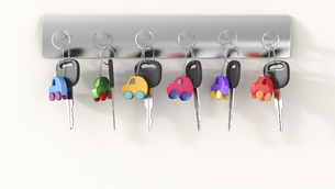 Car keys with different key ring hanging on key hook, electrのイラスト素材 [FYI04334153]