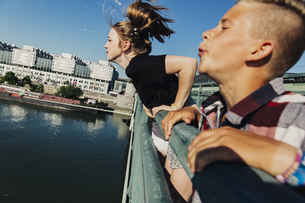 Austria, Vienna, two teenagers spitting from a bridgeの写真素材 [FYI04334264]