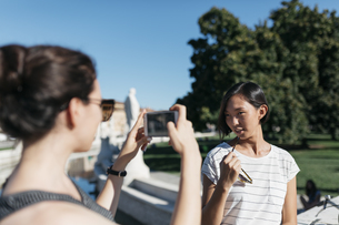 Italy Padua, young woman taking picture of her friend with sの写真素材 [FYI04334375]