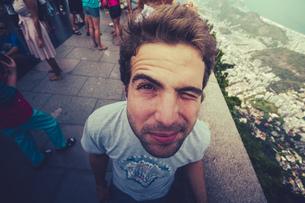 Brazil, Rio de Janeiro, Corcovado, Man twinkling his eyeの写真素材 [FYI04334555]