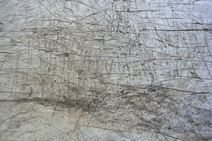 Withered and scratched wooden table, partial viewの写真素材 [FYI04335094]