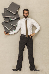Businessman holding stack of filesの写真素材 [FYI04335226]