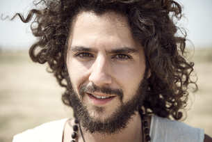Portrait of man with beard and curly hairの写真素材 [FYI04335461]
