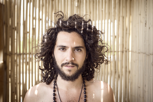 Portrait of man with beard and curly hairの写真素材 [FYI04335470]