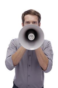 Young man holding megaphoneの写真素材 [FYI04335504]