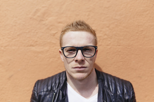 Portrait of strawberry blonde young man wearing black glasseの写真素材 [FYI04335561]