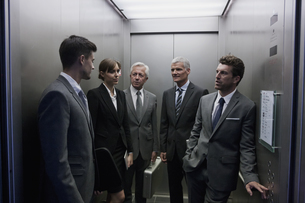 Group of businesspeople discussing in elevatorの写真素材 [FYI04335777]