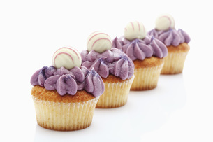 Close up of buttercream black currant cupcake with chocolateの写真素材 [FYI04336309]