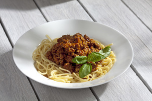 Spaghetti with Bolognese sauce, close upの写真素材 [FYI04336444]