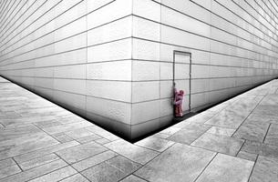 Norway, Oslo, Girl trying to open door of opera houseの写真素材 [FYI04336497]