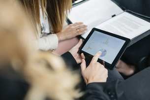 Two businesswomen with digital tablet and documents workingの写真素材 [FYI04336557]