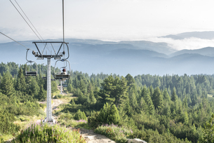 Bulgaria, Rila Mountains, senior woman using chairliftの写真素材 [FYI04336844]