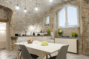 Interior of modern kitchen in old stone houseの写真素材 [FYI04337220]