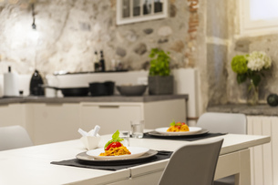 Modern kitchen in old stone house with freshly cooked pastaの写真素材 [FYI04337224]