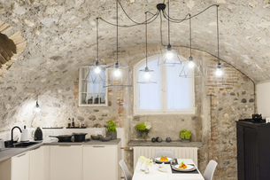 Modern kitchen in old stone house with freshly cooked pastaの写真素材 [FYI04337225]