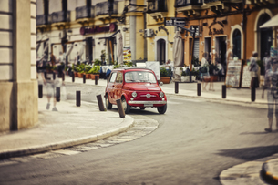 Italy, Apulia, Gallipoli, parking red Fiat 500, multiple expの写真素材 [FYI04337363]