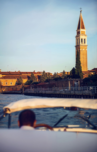 Italy, Venice, boat and driver with St Mark's Campanile in tの写真素材 [FYI04338281]