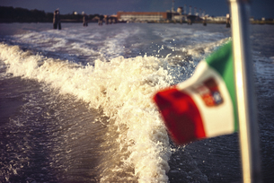 Italy, Venice, water trail from motor boatの写真素材 [FYI04338282]