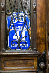 Two old house numbers at entry doorの写真素材 [FYI04338348]