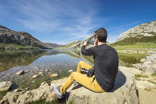 Spain, Asturias, Picos de Europa National Park, man taking pの写真素材 [FYI04338516]