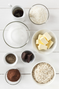 Bowls of ingredients for coco chocolate truffles on white woの写真素材 [FYI04338566]