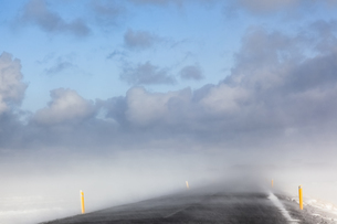 Iceland, Snaefellsnes, empty road, snow stormの写真素材 [FYI04338720]