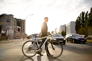 Germany, Berlin, Businessman cycling in the cityの写真素材 [FYI04339061]