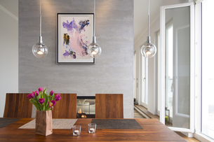 Interior of modern flat, Dining area and fireplaceの写真素材 [FYI04339220]