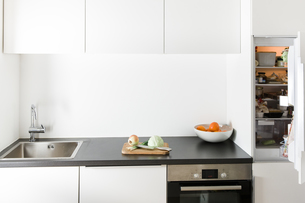 Modern kitchen, open fridgeの写真素材 [FYI04339421]