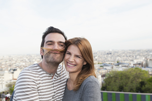 France, Paris, portrait of happy couple having funの写真素材 [FYI04339557]