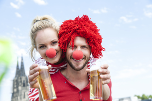 Germany, Cologne, young couple celebrating carnival dressedの写真素材 [FYI04339661]