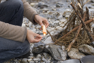 Austria, Salzburg County, Person setting up a fireの写真素材 [FYI04340744]