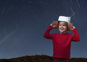 Croatia,Boy with space hat and star trail in the skyの写真素材 [FYI04341037]