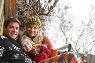 Austria, Salzburg, Huettau, Family smiling, portraitの写真素材 [FYI04341066]