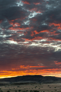 Africa, Namibia, Damaraland, dramatic sky at sunsetの写真素材 [FYI04341547]