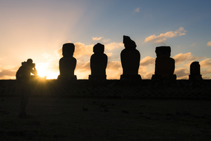 Chile, Easter Island, Man taking pictures of Moais at sunsetの写真素材 [FYI04341752]