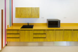 Estonia, kitchen unit with microwave in a newly built kinderの写真素材 [FYI04341819]