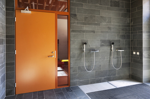 Estonia, shower for cleaning dirty shoes at entrance of a neの写真素材 [FYI04341834]