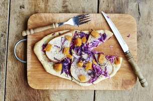 Flammkuchen with red cabbage, pears and non-dairy cheeseの写真素材 [FYI04341871]