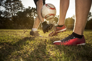 Legs of soccer players on soccer pitchの写真素材 [FYI04341938]