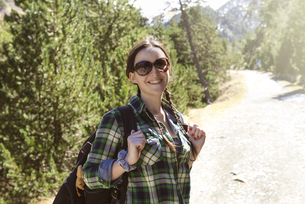 Spain, Catalonia, smiling woman with backpack hiking in theの写真素材 [FYI04341941]