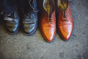 Hungary, Budapest, Worn leather shoes on the groundの写真素材 [FYI04342587]