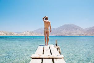 Greece, Cyclades islands, Amorgos, Aegean Sea, naked man staの写真素材 [FYI04342892]
