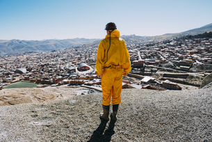 Bolivia, Potosi, back view of tourist wearing protective cloの写真素材 [FYI04342982]